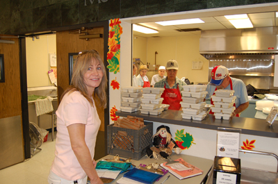 Rotary member, Marjorie Maxwell, picking up meals for her Meals on Wheels assignment.